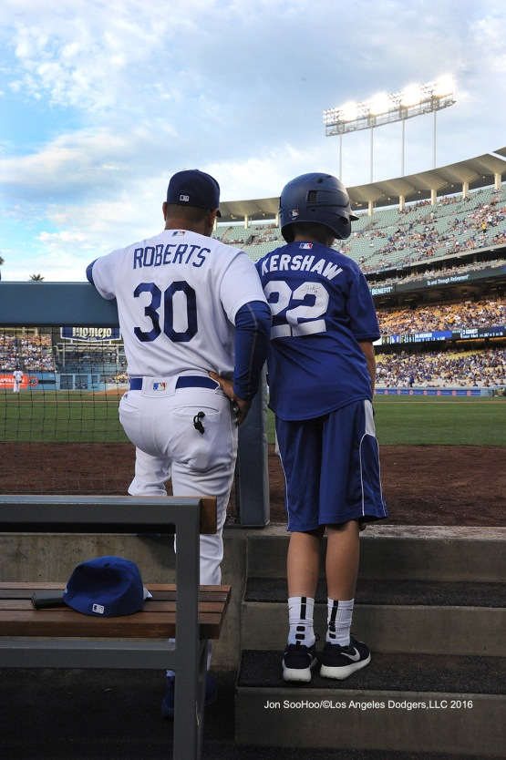 Andrew Finnegan in the dugout with Dave Roberts during Los Angeles Dodgers game against the Milwaukee Brewers Satuday, June 18, 2016 at Dodger Stadium. Photo by Jon SooHoo