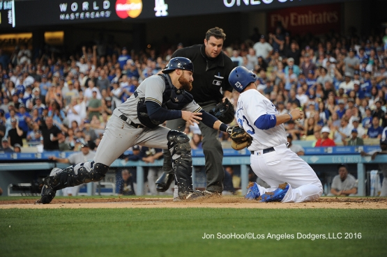 Los Angeles Dodgers Adrian Gonzalez is tagged out at the plate during game against the Milwaukee Brewers Satuday, June 18, 2016 at Dodger Stadium. Photo by Jon SooHoo