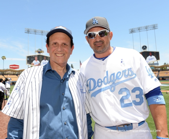 Honorary first pitch participant Michael Milken and Adrian Gonzalez pose for a photo prior to the start of the game. Jill Weisleder/Dodgers