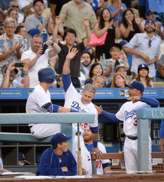 Chase Utley waves to the crowd as he gets his 1,000 career run. Jill Weisleder/Dodgers