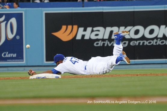 Los Angeles Dodgers Howie Kendrick can't get ball during game against the Milwaukee Brewers Satuday, June 18, 2016 at Dodger Stadium. Photo by Jon SooHoo