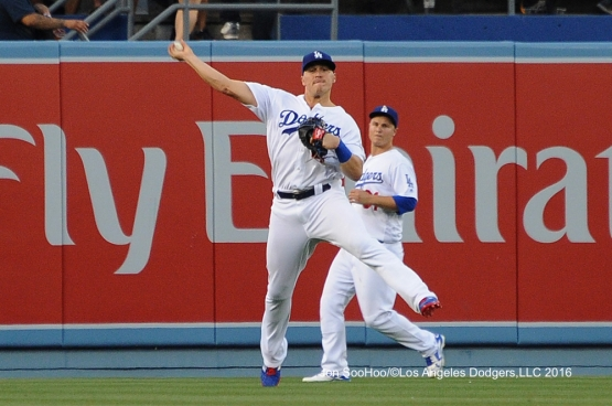 Los Angeles Dodgers Kike Hernandez throws the ball back to the infield during game against the Milwaukee Brewers Satuday, June 18, 2016 at Dodger Stadium. Photo by Jon SooHoo