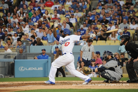 Los Angeles Dodgers Howie Kendrick homers  during game against the Milwaukee Brewers Satuday, June 18, 2016 at Dodger Stadium. Photo by Jon SooHoo