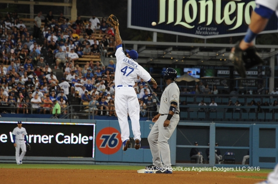 Los Angeles Dodgers Howie Kendrick goes up for ball during game against the Milwaukee Brewers Satuday, June 18, 2016 at Dodger Stadium. Photo by Jon SooHoo