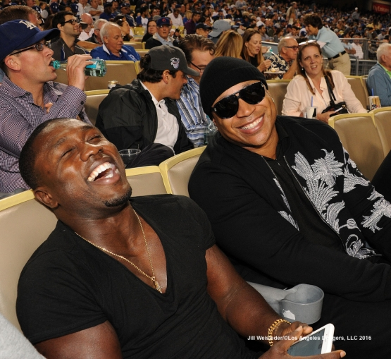 Rapper and actor LL Cool J smiles as he takes in the Dodgers and Milwaukee Brewers game. Jill Weisleder/Dodgers
