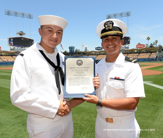 U.S. Navy E4 Brian Mares of La Mesa is reenlisted during pre-game festivities. Jill Weisleder/Dodgers