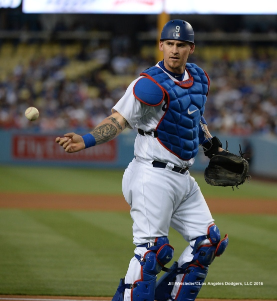 Yasmani Grandal tosses a ball. Jill Weisleder/Dodgers