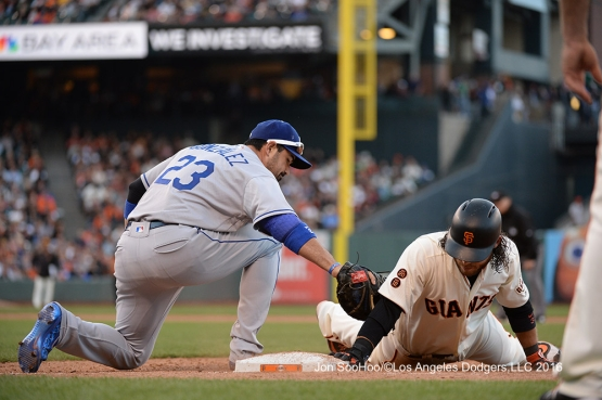 Los Angeles Dodgers Adrian Gonzalez on the tag against the San Francisco Giants Saturday, June 11, 2016 at AT&T Park in San Francisco, California. Photo by Jon SooHoo/© Los Angeles Dodgers,LLC 2016