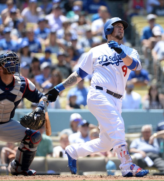Catcher Yasmani Grandal watches his ball take flight as he connects for a three-run home run in the third inning.  Jill Weisleder/Dodgers