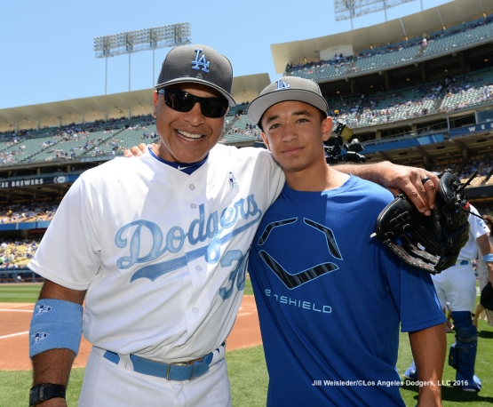 Dodger manager Dave Roberts and his son Cole pose for a photo during Father's Day pre-game festivities. Jill Weisleder/Dodgers
