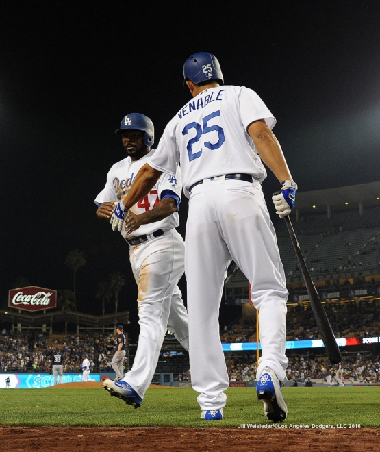 Will Venable high-fives Howie Kendrick as he comes in to score. Jill Weisleder/Dodgers