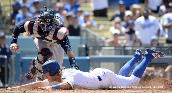 Kike Hernandez attempts to slide safely under the glove of Atlanta Braves catcher A.J. Pierzynski but is tagged out at home plate. Jill Weisleder/Dodgers