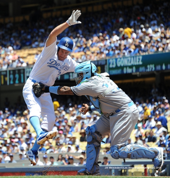 Chase Utley is tagged out at home plate by Milwaukee Brewers catcher Martin Maldonado. Jill Weisleder/Dodgers