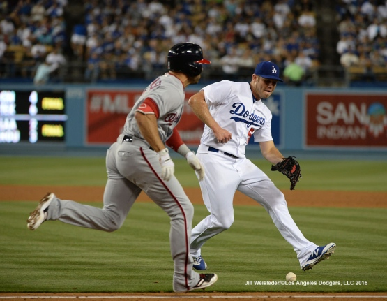 Pticher Casey Fien makes a play to get out Danny Espinosa at first base. Jill Weisleder/Dodgers