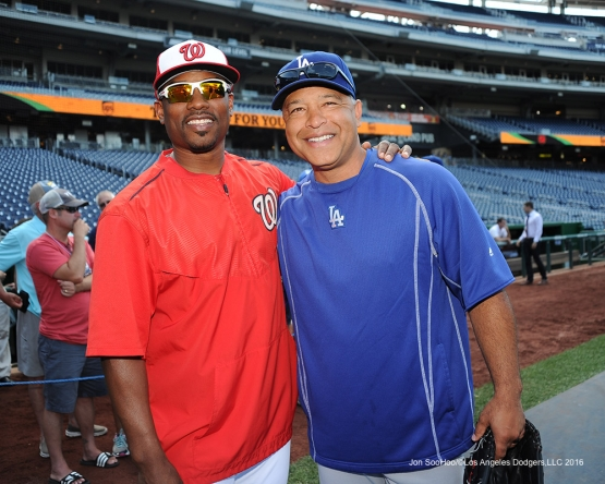 A Trojan (Jacques Jones) and a Bruin (Dave Roberts) pose before game against the Washington Nationals Wednesday, July 20, 2016 at Nationals Park in Washington,DC. Photo by Jon SooHoo/©Los Angeles Dodgers,LLC 2016