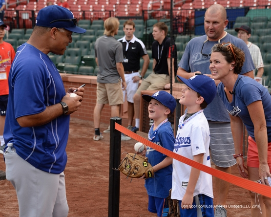 Los Angeles Dodgers Dave Roberts signs prior to  game against the St. Louis Cardinals at Busch Stadium Friday, July 22, 2016 in St.Louis, Missouri.  Photo by Jon SooHoo/©Los Angeles Dodgers,LLC 2016