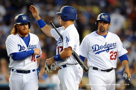Justin Turner and Adrian Gonzalez are greeted by A.J. Ellis after scoring in the third inning.