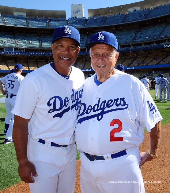 Current Dodgers manager Dave Roberts and former manager Tommy Lasorda, pose for a photo.