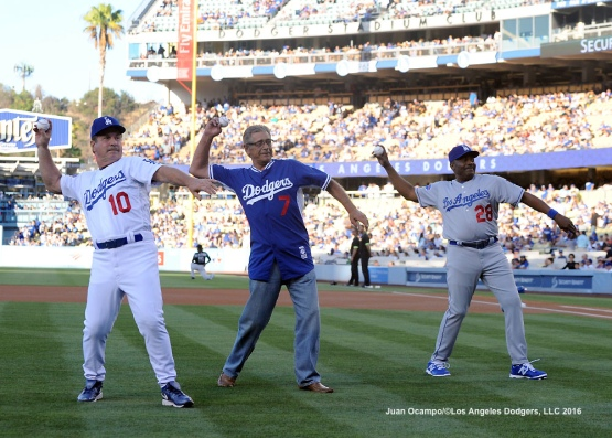 Ron Cey, Steve Yeager and Pedro Guerrero throw out the ceremonial first pitch before the game.