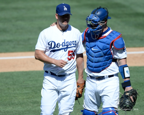 Los Angeles Dodgers Yasmani Grandal puts arm around Joe Blanton's shoulder during game against the Colorado Rockies Sunday, July 3, 2016 at Dodger Stadium in Los Angeles, California. Photo by Jon SooHoo/©Los Angeles Dodgers,LLC 2016