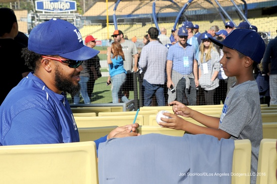Kenley Jansen signs for fan--Los Angeles Dodgers during game against the Baltimore Orioles Tuesday, July 5, 2016 at Dodger Stadium in Los Angeles, California. Photo by Jon SooHoo/©Los Angeles Dodgers,LLC 2016