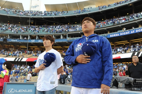 Ji-Sung and Hyun-jin Ryu stand for anthem--Los Angeles Dodgers during game against the Baltimore Orioles Tuesday, July 5, 2016 at Dodger Stadium in Los Angeles, California. Photo by Jon SooHoo/©Los Angeles Dodgers,LLC 2016