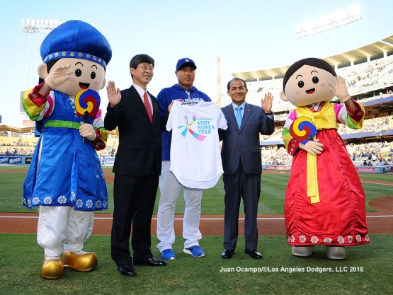 The Dodgers Hyun-Jin Ryu is recognized by Korean Consulate General, Mr. Key-Chul Lee and Director of Kortean Torism, Mr. Tae Shik before the game against the Orioles.