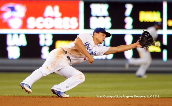 Corey Seager reaches for the line drive.
