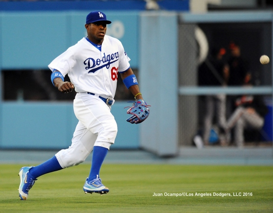 Yasiel Puig chases down the fly ball.