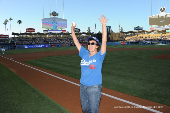 Great Dodger fan Emma Amaya waves to the crowd before throwing out the ceremonial first pitch  Wednsday, July 7, 2016 at Dodger Stadium in Los Angeles, California. Photo by Jon SooHoo/©Los Angeles Dodgers,LLC 2016