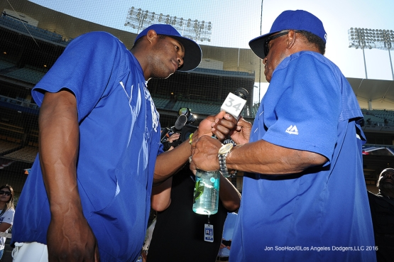 Yasiel Puig interviews Manny Mota--Los Angeles Dodgers during game against the San Diego Thursday, July 8, 2016 at Dodger Stadium in Los Angeles, California. Photo by Jon SooHoo/©Los Angeles Dodgers,LLC 2016