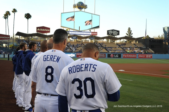 Los Angeles Dodgers stand for a moment of silence prior to game against the San Diego Friday, July 8, 2016 at Dodger Stadium in Los Angeles, California. Photo by Jon SooHoo/©Los Angeles Dodgers,LLC 2016