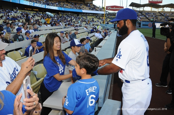 Los Angeles Dodgers Andrew Toles signs for fans prior to game against the San Diego Friday, July 8, 2016 at Dodger Stadium in Los Angeles, California. Photo by Jon SooHoo/©Los Angeles Dodgers,LLC 2016