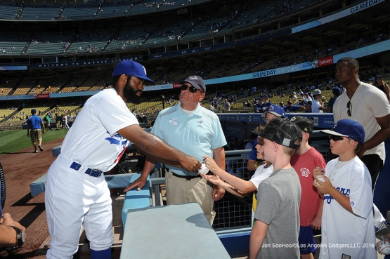 Los Angeles Dodgers Andrew Toles signs for fans prior to game against the San Diego Padres Saturday, July 9, 2016 at Dodger Stadium in Los Angeles, California. Photo by Jon SooHoo/©Los Angeles Dodgers,LLC 2016