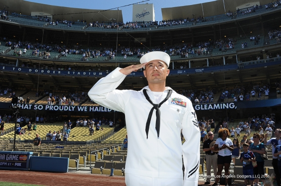 Military Hero of the Game US Navy Petty Officer Second Class, Jesus Saucedo salutes the flag prior to Los Angeles Dodgers game against the San Diego Padres Saturday, July 9, 2016 at Dodger Stadium in Los Angeles, California. Photo by Jon SooHoo/©Los Angeles Dodgers,LLC 2016