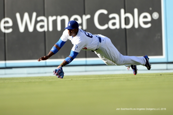Los Angeles Dodgers Yasiel Puig makes diving catch during game against the San Diego Saturday, July 9, 2016 at Dodger Stadium in Los Angeles, California. Photo by Jon SooHoo/©Los Angeles Dodgers,LLC 2016