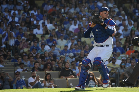 Los Angeles Dodgers Yasmani Grandal makes play during game against the San Diego Padres Saturday, July 9, 2016 at Dodger Stadium in Los Angeles, California. Photo by Jon SooHoo/©Los Angeles Dodgers,LLC 2016
