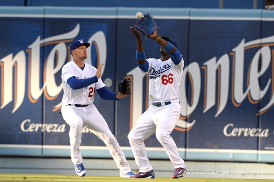 Los Angeles Dodgers Yasiel Puig makes catch in front of Trayce Thompson during game against the San Diego Padres Saturday, July 9, 2016 at Dodger Stadium in Los Angeles, California. Photo by Jon SooHoo/©Los Angeles Dodgers,LLC 2016