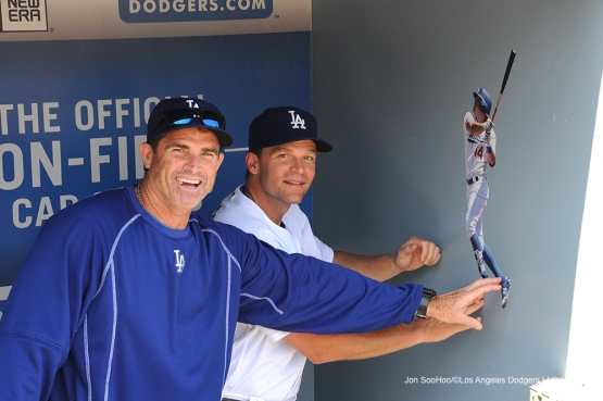 Turner Ward and Tim Hyers put up their Kike Hernandez Fathead prior to game against the San Diego Padres Sunday, July 10 2016 at Dodger Stadium in Los Angeles, California. Photo by Jon SooHoo/©Los Angeles Dodgers,LLC 2016