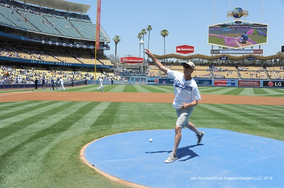 Tennis star Sam Query throws out the first pitch before Los Angeles Dodgers game against the San Diego Padres Sunday, July 10 2016 at Dodger Stadium in Los Angeles, California. Photo by Jon SooHoo/©Los Angeles Dodgers,LLC 2016