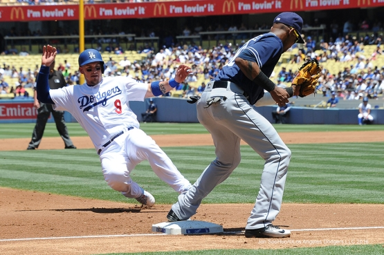 Los Angeles Dodgers Yasmani Grandal is out at third during game against the San Diego Padres Sunday, July 10 2016 at Dodger Stadium in Los Angeles, California. Photo by Jon SooHoo/©Los Angeles Dodgers,LLC 2016