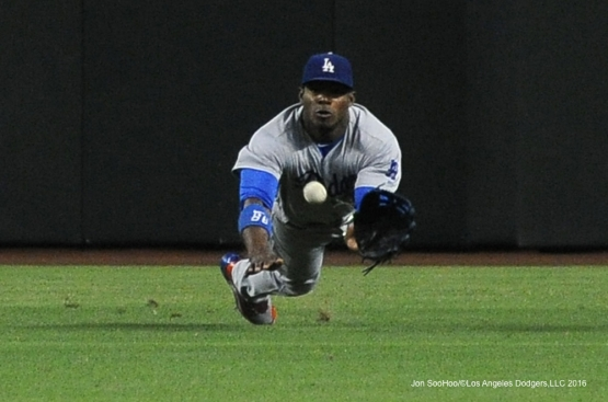 Los Angeles Dodgers Yasiel Puig can't get to ball during game against the Arizona Diamondbacks Sunday, July 17, 2016 at Chase Field in Phoenix, Arizona. Photo by Jon SooHoo/©Los Angeles Dodgers,LLC 2016