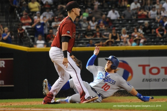 Los Angeles Dodgers Justin Turner is safe at third during game against the Arizona Diamondbacks Sunday, July 17, 2016 at Chase Field in Phoenix, Arizona. Photo by Jon SooHoo/©Los Angeles Dodgers,LLC 2016