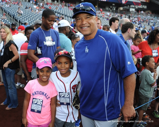 Los Angeles Dodgers Dave Roberts poses with fans prior to game against the Washington Nationals Tuesday, July 19, 2016 at Nationals Park in Washington,DC. Photo by Jon SooHoo/©Los Angeles Dodgers,LLC 2016