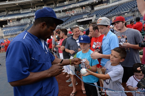 Los Angeles Dodgers Yasiel Puig signs prior to game against the Washington Nationals Tuesday, July 19, 2016 at Nationals Park in Washington,DC. Photo by Jon SooHoo/©Los Angeles Dodgers,LLC 2016