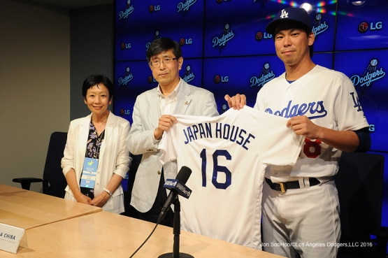 Los Angeles Dodgers Kenta Maeda poses with Consul General of Japan, Akira Chiba and President of Japan House, Yuko Kaifu prior to game against the Tampa Bay Rays Tuesday, July 26,2016 at Dodger Stadium in Los Angeles,California. Photo by Jon SooHoo©Los Angeles Dodgers,LLC 2016
