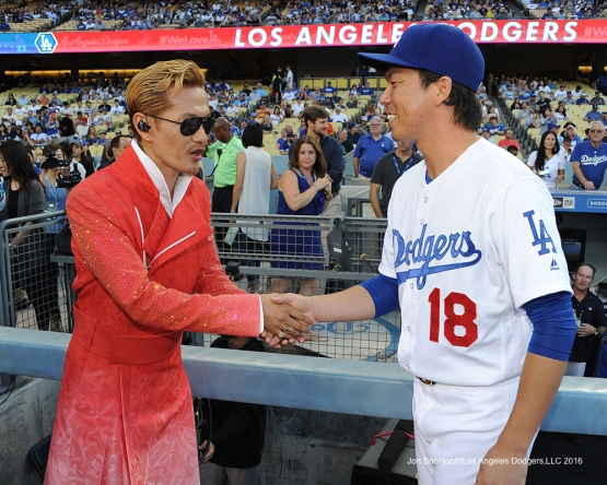 Exile Atsushi shakes hands with Kenta Maeda prior to game against the Tampa Bay Rays Tuesday, July 26,2016 at Dodger Stadium in Los Angeles,California. Photo by Jon SooHoo©Los Angeles Dodgers,LLC 2016