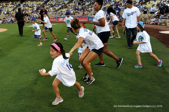 Kids take the field prior to Los Angeles Dodgers game against the Tampa Bay Rays Tuesday, July 26,2016 at Dodger Stadium in Los Angeles,California. Photo by Jon SooHoo©Los Angeles Dodgers,LLC 2016