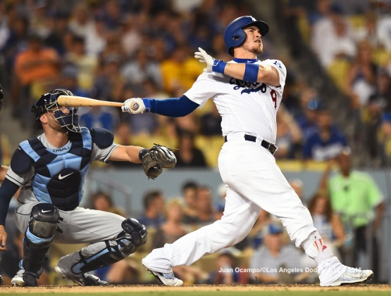 Yasmani Grandal hits a solo home run in the seventh inning.