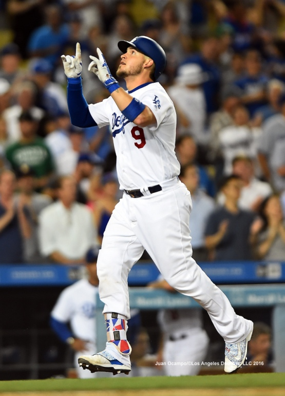 Yasmani Grandal points up to the sky after his home run in the seventh inning.